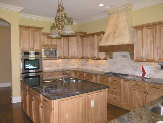 Kitchen island, appliances, lighting, flooring, countertops
